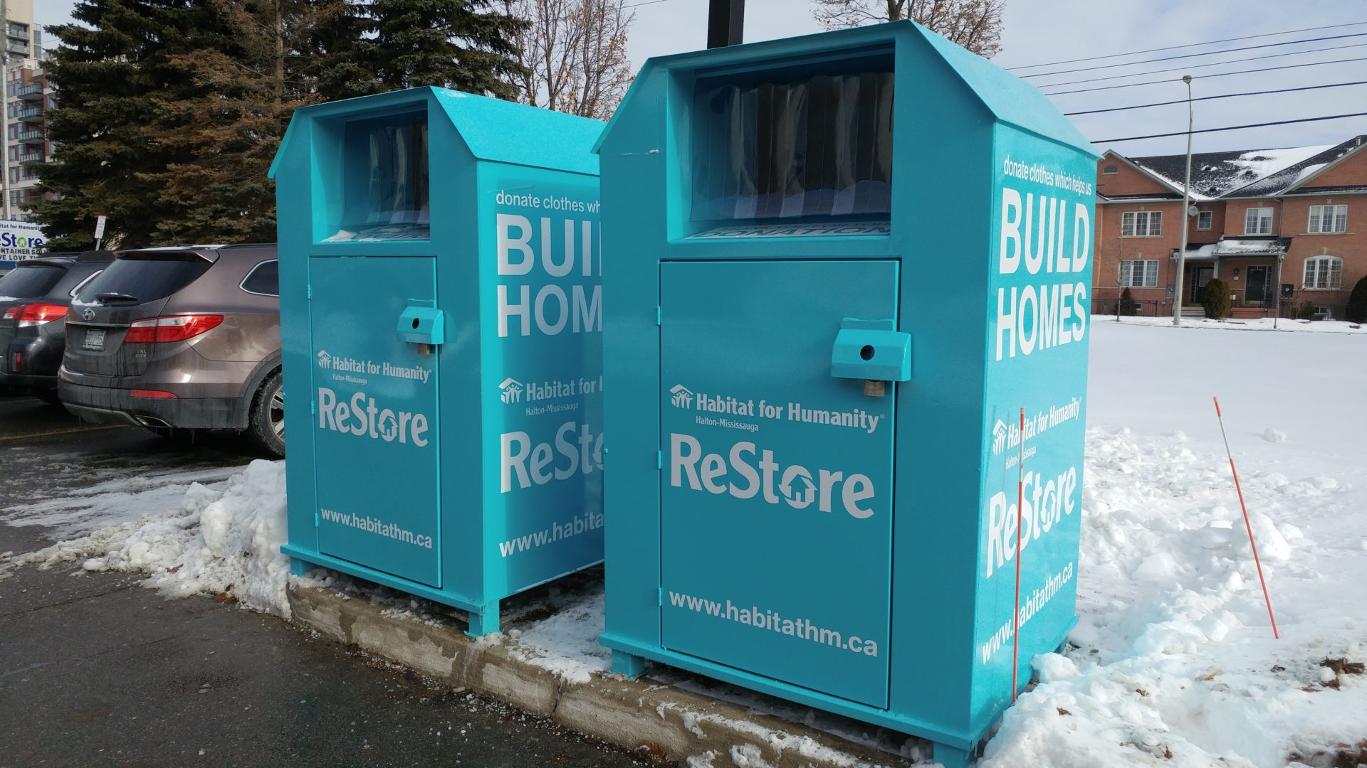 Habitat's bright blue donation bins in our Burlington ReStore parking lot.